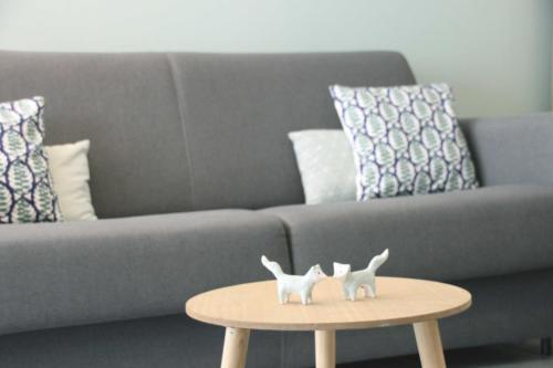 Salon scandinave vert d'eau - Espace TV